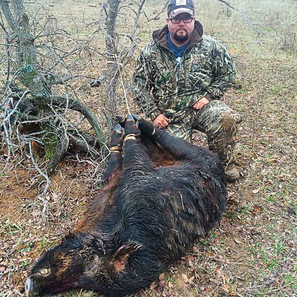 Chris Wilson a rancher and hunter with a feral hog