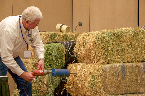 Jody Gale demonstrating taking a hay sample