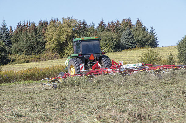 Using a tedder to help with drydown on late-season grass hay.