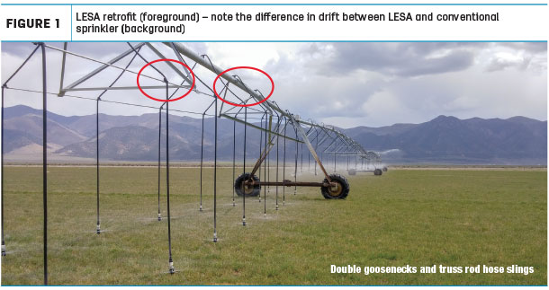 LESA tetrofit (foreground) - note the difference in drift between LESA and conventional sprinkler (background)