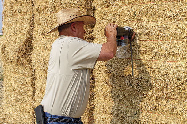 Glenn Shewmaker, uses manual hay probe
