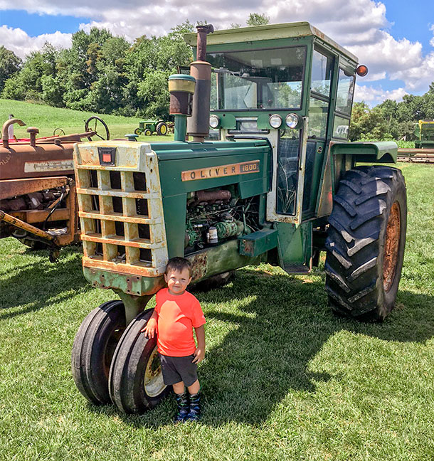 My son, Griffin, at our 2018 show proudly standing by his dad's 1964 Oliver 1800-C with Full View cab