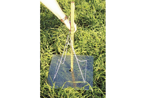 A resting plate meter is being used to measure pasture height