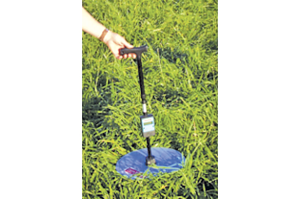 A commercial rising plae meter is being used to measure pasture height with forage mass